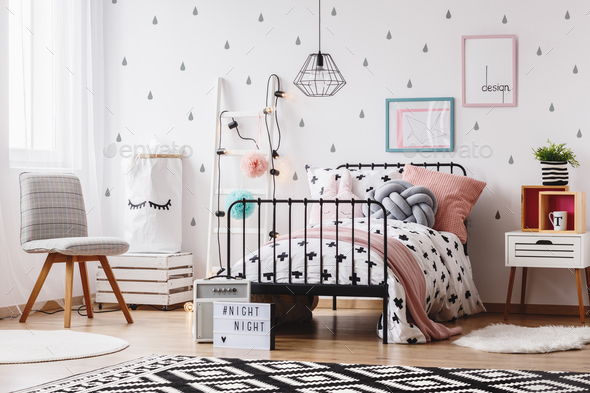 Grey chair in girl's bedroom - Stock Photo - Images