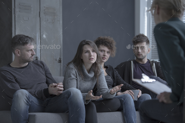 Young people taking about addiction - Stock Photo - Images