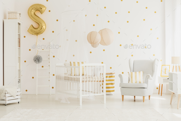 Golden balloon pinned to ladder - Stock Photo - Images