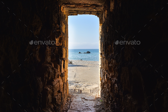 Sea view through ancient tunnel - Stock Photo - Images