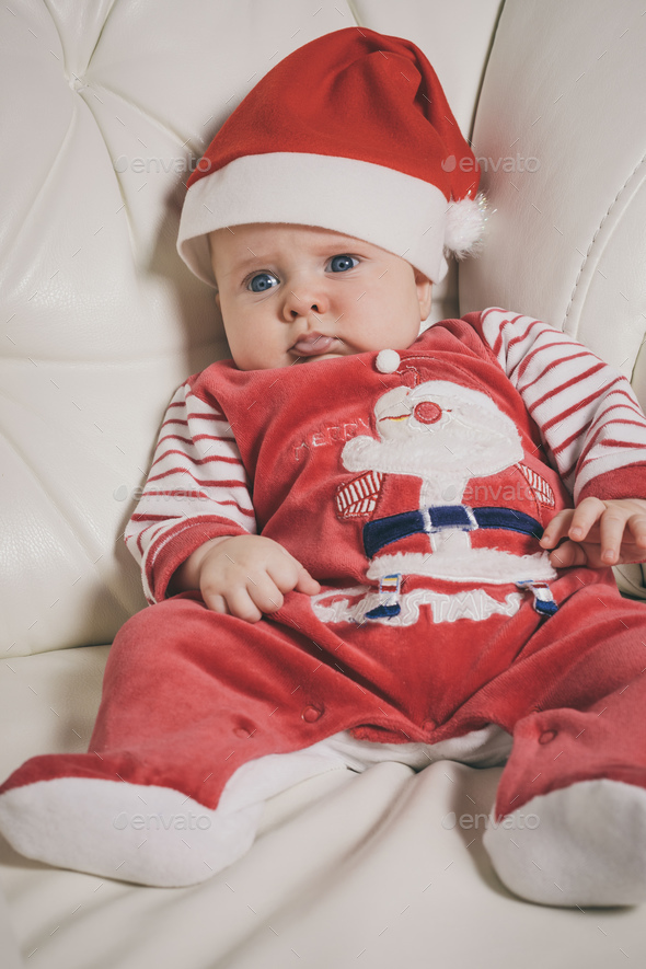 Happy  baby in Santa costume. - Stock Photo - Images