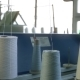Spools with White Thread at Rewinding Machine Video - VideoHive Item for Sale