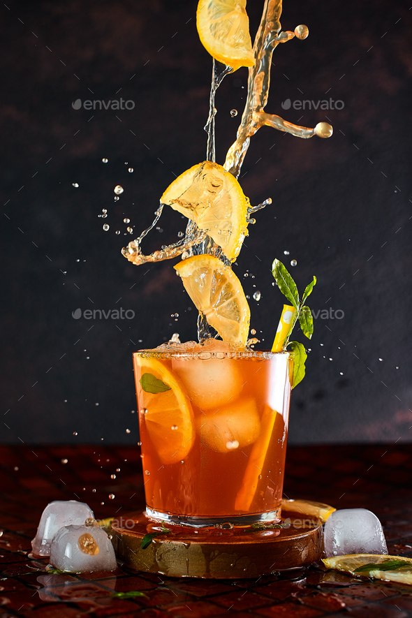Iced lemon tea in motion concept. - Stock Photo - Images