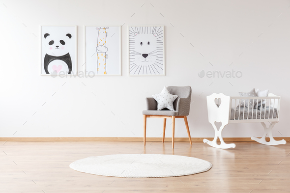 White crib in baby's room - Stock Photo - Images