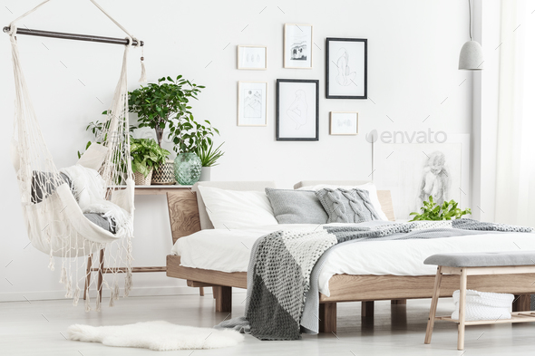 Hammock and posters in bedroom - Stock Photo - Images