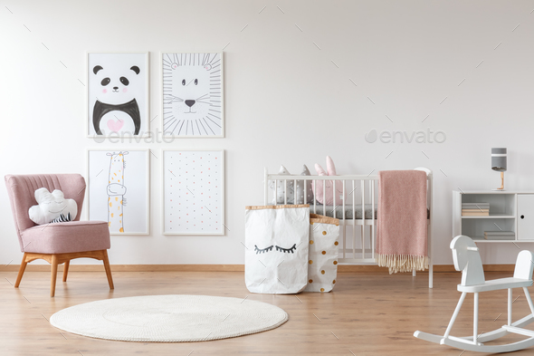 Pink armchair in child's room - Stock Photo - Images