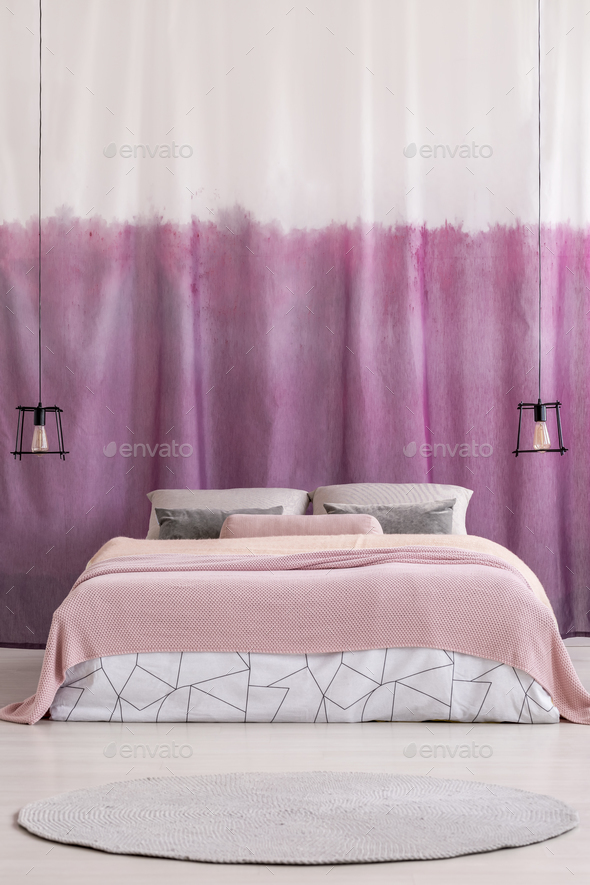 King-size bed with pink blanket - Stock Photo - Images