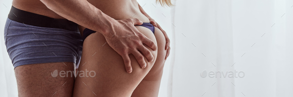 Man's hands on woman's buttocks - Stock Photo - Images
