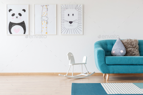 Kid's drawings in living room - Stock Photo - Images