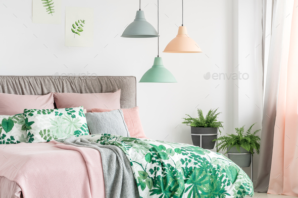 Three lamps above bed - Stock Photo - Images