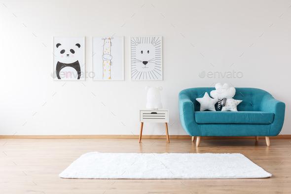 Aquamarine sofa in kid's room - Stock Photo - Images
