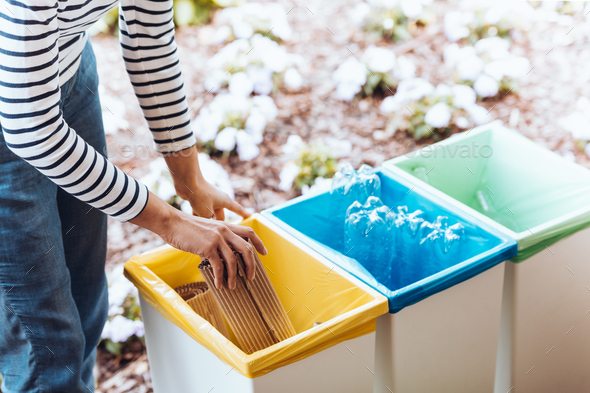 Person disposing of paper - Stock Photo - Images