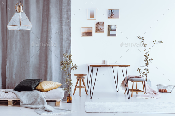 Dining room with grey bed - Stock Photo - Images