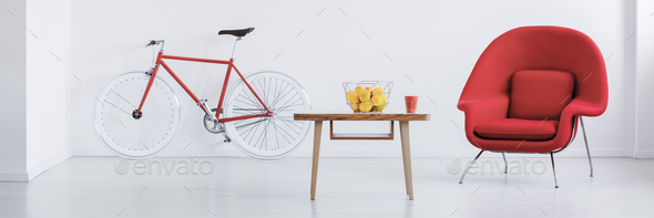 Red bike in stylish studio - Stock Photo - Images