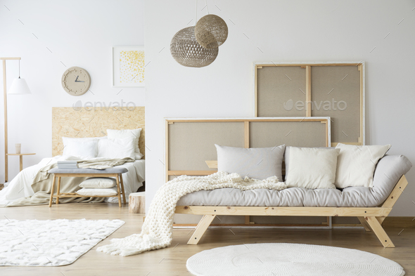 Bed and sofa in room - Stock Photo - Images