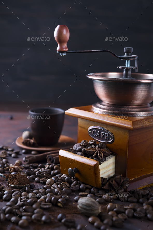 Old vintage grinder with roasted coffee beans and grind coffee on stone background. - Stock Photo - Images
