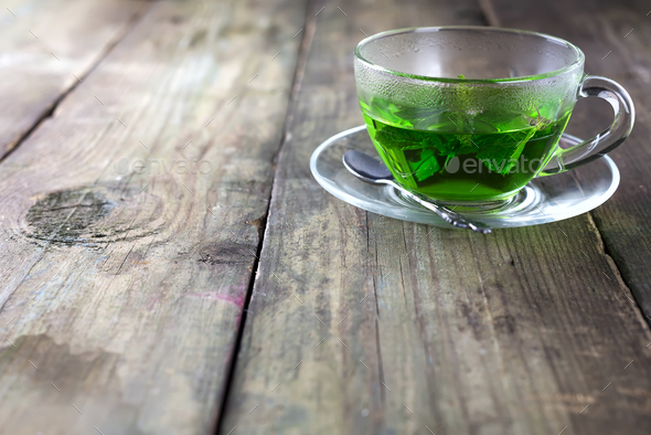 Peppermint tea in a glass cup on the table - Stock Photo - Images