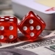 Red Bones on the Gaming Table with Dollars and Chips for the Game - VideoHive Item for Sale