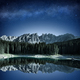 mountain range and fir forest reflecting in alpine lake at night - PhotoDune Item for Sale