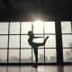 Silhouette of an Athlete Against the Background of a Large Window. Sports Girl Doing Warm-up Before - VideoHive Item for Sale