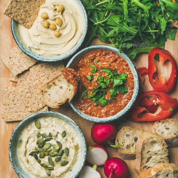Flat-lay of Vegetarian dips hummus, babaganush, muhammara, square crop - Stock Photo - Images