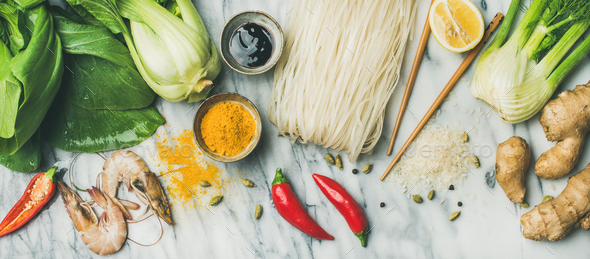 Flat-lay of Asian cuisine ingredients over grey marble background - Stock Photo - Images