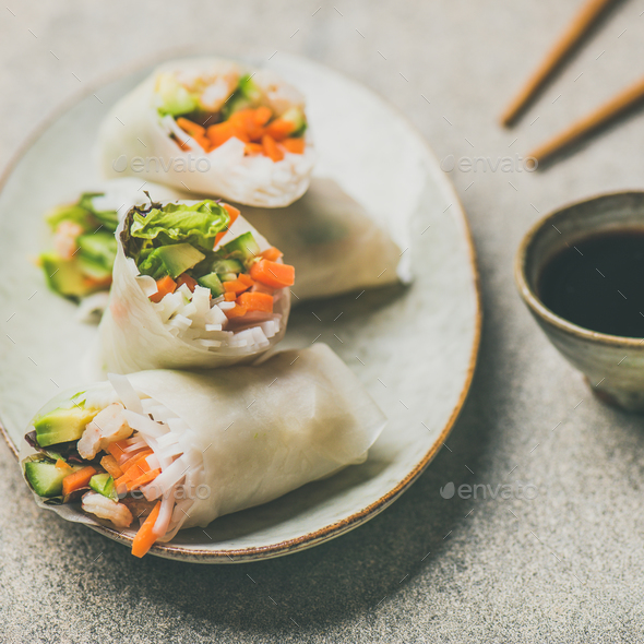 Shrimp and vegetable rice paper rolls, grey background, square crop - Stock Photo - Images
