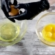 Fresh Eggs Falling Into Bowl. Egg Yolk Falling in Glass Bowl. Separating the Yolk From the Protein. - VideoHive Item for Sale
