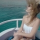 . Beautiful Girl in a Bikini, on a Yacht Poses on the Background of the Ocean Hair Develops in the - VideoHive Item for Sale