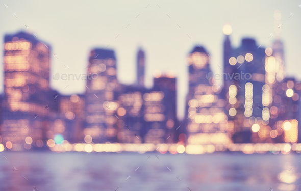Blurred vintage toned picture of Manhattan skyline at night, NYC - Stock Photo - Images