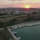 Flying Over the Quay and House Roofs at Sunset. Nea Kallikratia, Greece - VideoHive Item for Sale