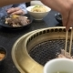 Korean Barbecue Grill. People Cook and Eat Dishes Cooked on a Korean Grill in a Restaurant - VideoHive Item for Sale