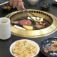 Korean Barbecue Grill People Cook and Eat Dishes Cooked on a Korean Grill in a Restaurant - VideoHive Item for Sale