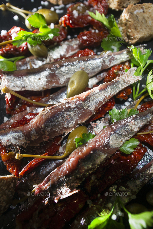 Anchovies tomatoes and capers - Stock Photo - Images