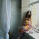 Young Beautiful Pregnant Girl Sits Near a Window - VideoHive Item for Sale