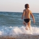 Child Enjoying Vacation on the Coast and Running Into Sea To Swim - VideoHive Item for Sale