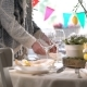 Young Woman Setting Easter Festive Table with Bunny and Eggs Decoration - VideoHive Item for Sale