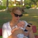 Woman Using Mobile During Outing with Baby in the Park - VideoHive Item for Sale