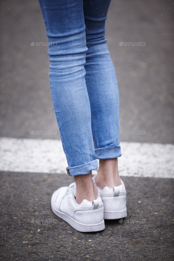 Male legs with jeans and sneakers. Hipster trendy people. Vertical - Stock Photo - Images