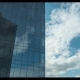 Clouds Moving and Reflecting in Glassy Skyscraper - VideoHive Item for Sale