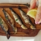 Pouring Lemon Juice on Grilled Sardines - VideoHive Item for Sale