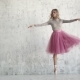 an Elegant Young Ballerina Is Dancing a Classical Ballet on the Background of a Huge Light Window - VideoHive Item for Sale