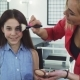 Happy Little Girl Smiling While Her Mom Applying Makeup on Her Face - VideoHive Item for Sale