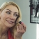 Gorgeous Woman Smiling Applying Makeup - VideoHive Item for Sale