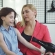 Beautiful Woman Drying Hair of Her Daughter with a Hairdryer at the Beauty Salon - VideoHive Item for Sale