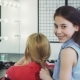 Cute Cheerful Little Girl Braiding Hair of Her Mom Smiling To the Camera - VideoHive Item for Sale