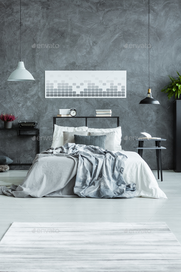 Geometric poster in man's bedroom - Stock Photo - Images