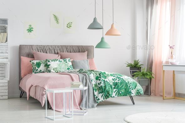 Pastel bedding on stylish bed - Stock Photo - Images