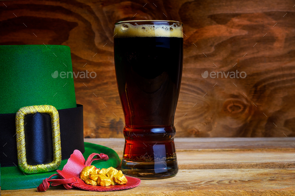 Saint Patrick day symbols green hat and leprechaun gold - Stock Photo - Images