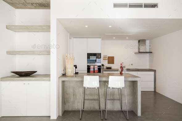 modern kitchen with gray tile floor and white wall - Stock Photo - Images